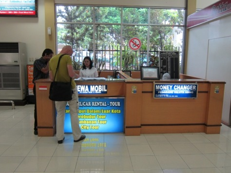 car rental and money changer inside domestic arrival terminal of Adisutjipto International Airport, Yogyakarta