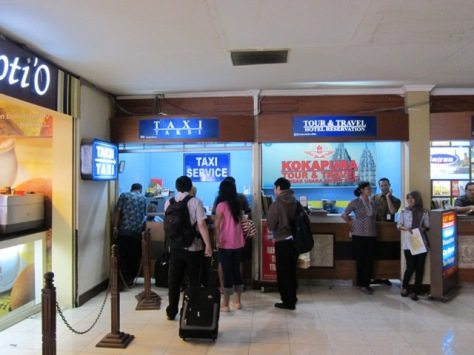 Taxi counter on the right after exit door of domestic arrival building of Adisutjipto International Airport, Yogyakarta
