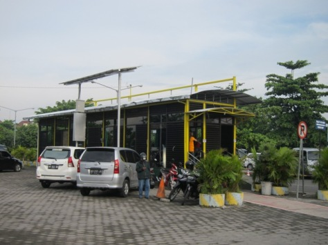TransJogja bus stop on the parking area of Adisutjipto International Airport