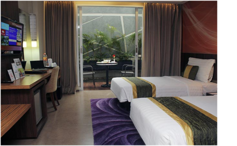 Kamar yang nyaman dengan bed empuk